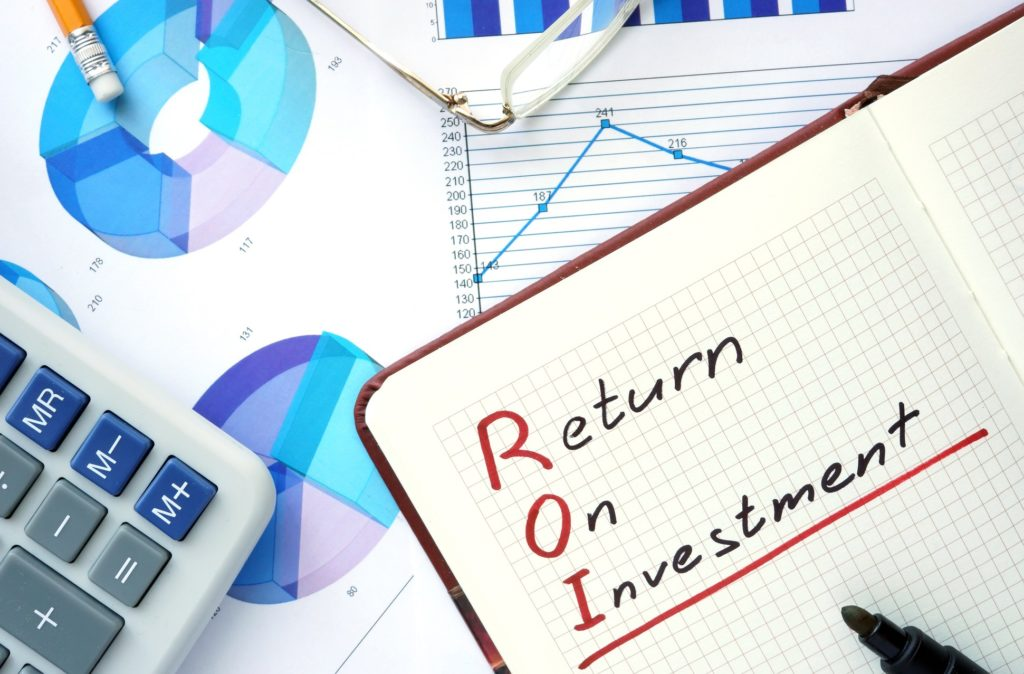 Notepad with word ROI return on investment concept and marker.
